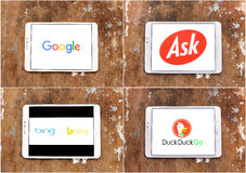 Search engines google , ask , bing , duckduckgo. Logos of search engines google , ask , bing , duckduckgo displayed on white tablet on rusted wooden background Stock Photo