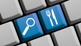 Search for Food and Restaurants online - Computer Keyboard. Computer Keyboard with symbols is showing search for Food and Restaurants online Stock Images