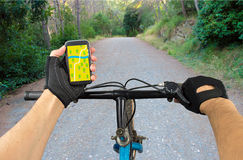 Search GPS coordinates in bike. View a map on the mobile phone on a mountain bike and search GPS coordinates Royalty Free Stock Photos