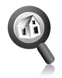Search home. Home under the magnifying Glass on isolated background Royalty Free Stock Photography