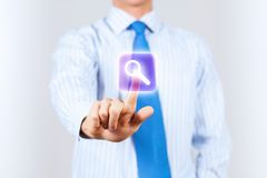 Search icon. Close up of businessman touching search icon Stock Images