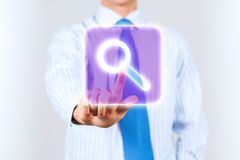 Search icon. Close up of businessman touching search icon Stock Image