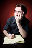 In Search Of Inspiration. A man with an empty notebook Royalty Free Stock Photography