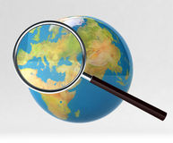 Search on internet. 3d globe under magnifying glass Royalty Free Stock Photo