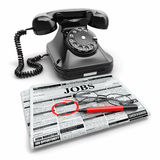 Search job. Newspaper with advertisments, glasses and phone Stock Photo