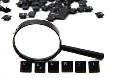 Search (keyboard keys) and magnify glass Royalty Free Stock Images