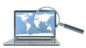 Search. Laptop and loupe in white background Stock Photography