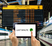 Search for last minute deals in station train. Man search for last minute deals at station train with your tablet Stock Photo