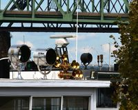 Search lights and horns. 2 large searchlights and air horns on top of the wheelhouse of a sternwheeler Stock Photography