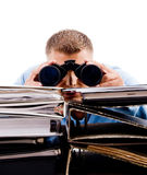 Search - looking through binoculars and book Stock Photos