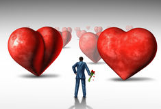Search For Love. And relationship difficulties as a businessman holding a bouquet of red roses looking at a three dimensional landscape of heart shaped objects Royalty Free Stock Images
