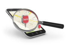 Search on the map. Magnifying glass over smartphon on white Royalty Free Stock Photography