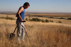 Search with a metal detector royalty free stock images