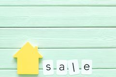 Search for a new house concept with house figure and sell copy on mint green background top view space for text. Search for a new house concept with house figure stock photos