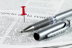 Search in a newspaper Stock Photo