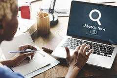 Search Now Exploration Discover Searching Finding Concept. Woman searching info on Laptop stock photo