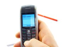 Search number. Hand holding mobile phone dialing a number Stock Photo