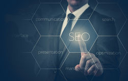 Search optimization business pointing finnger selecting seo.  Royalty Free Stock Image