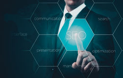 Search optimization business pointing finnger selecting seo Stock Photos