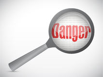 Search for possible danger. magnify glass Royalty Free Stock Image