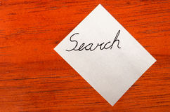 Search - Post it Note on Wood Background Stock Image