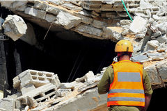 Search and Rescue Through Building Rubble Stock Image