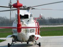 Search and rescue helicopter. Rear view of Sikorsky search and rescue helicopter on runway royalty free stock image