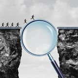 Search Solution Success. Search solution as business internet browsing answers as a group of people crossing a cliff helped by a giant magnifying glass with 3D Stock Photography