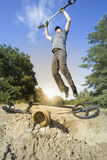 Search for treasure using a metal detector and shovel. Stock Images