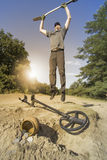 Search for treasure using a metal detector and shovel. Royalty Free Stock Photos