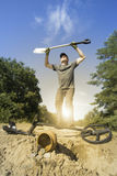 Search for treasure using a metal detector and shovel. Royalty Free Stock Images