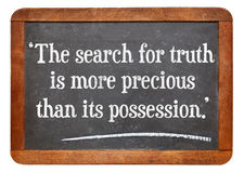 Search for truth quote. The search for truth is more precious than its possession - a quote from Albert Einstein on a vintage slate blackboard stock photos