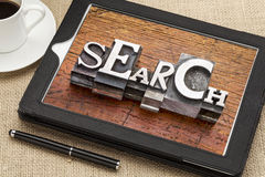 Search word on digital tablet, Stock Images