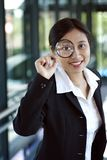 Searching. Businesswoman with magnifying glasses Royalty Free Stock Images