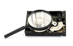 Searching. Magnifier searching hard disk drive isolated royalty free stock photo