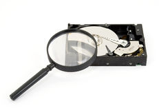 Searching. Magnifier searching hard disk drive isolated Royalty Free Stock Images