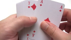 Searching for the Ace of Spades. Person searching for the ace of spades in a card deck. Canon HV30. HD 16:9 1920 x 1080 at 25.00 fps. Progressive scan. Photo JPG stock footage