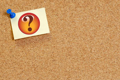 Searching for answers. Question mark on note pinned on corkboard background Royalty Free Stock Image