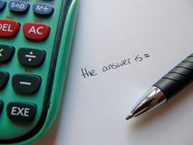 Searching for answers with calculator and pen Royalty Free Stock Photography