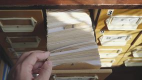 Searching in archives. Student hands searching from a filling cabinet. Searching in archives. Student hands searching from a filling cabinet stock footage