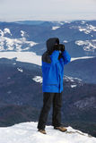 Searching with binocular. Man searching with binocular on mountain stock image
