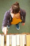 Searching a book Stock Photos