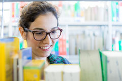 Searching for Books at Library Stock Photos