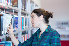 Searching for Books at Library Royalty Free Stock Photography