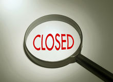 Searching closed. Magnifying glass with the word closed. Searching closed Stock Image
