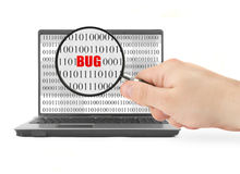 Searching for computer bug. Hand with magnifying glass is searching for computer bug, binary code is abstract royalty free stock photos