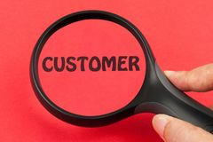 Searching for customer. Using magnifier on hand royalty free stock photography