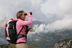 Searching the destination while hiking in the mountains Royalty Free Stock Photos