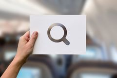 Searching discovery perforated paper magnifying glass. Female hand holding paper blank with searching discovery perforated paper magnifying glass Royalty Free Stock Photo