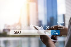 Searching Engine Optimizing SEO Browsing Concept, Businessman ho. Lding phone for looking information with technology and internet icon Stock Photos
